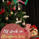 elf stuck in christmas tree decoration